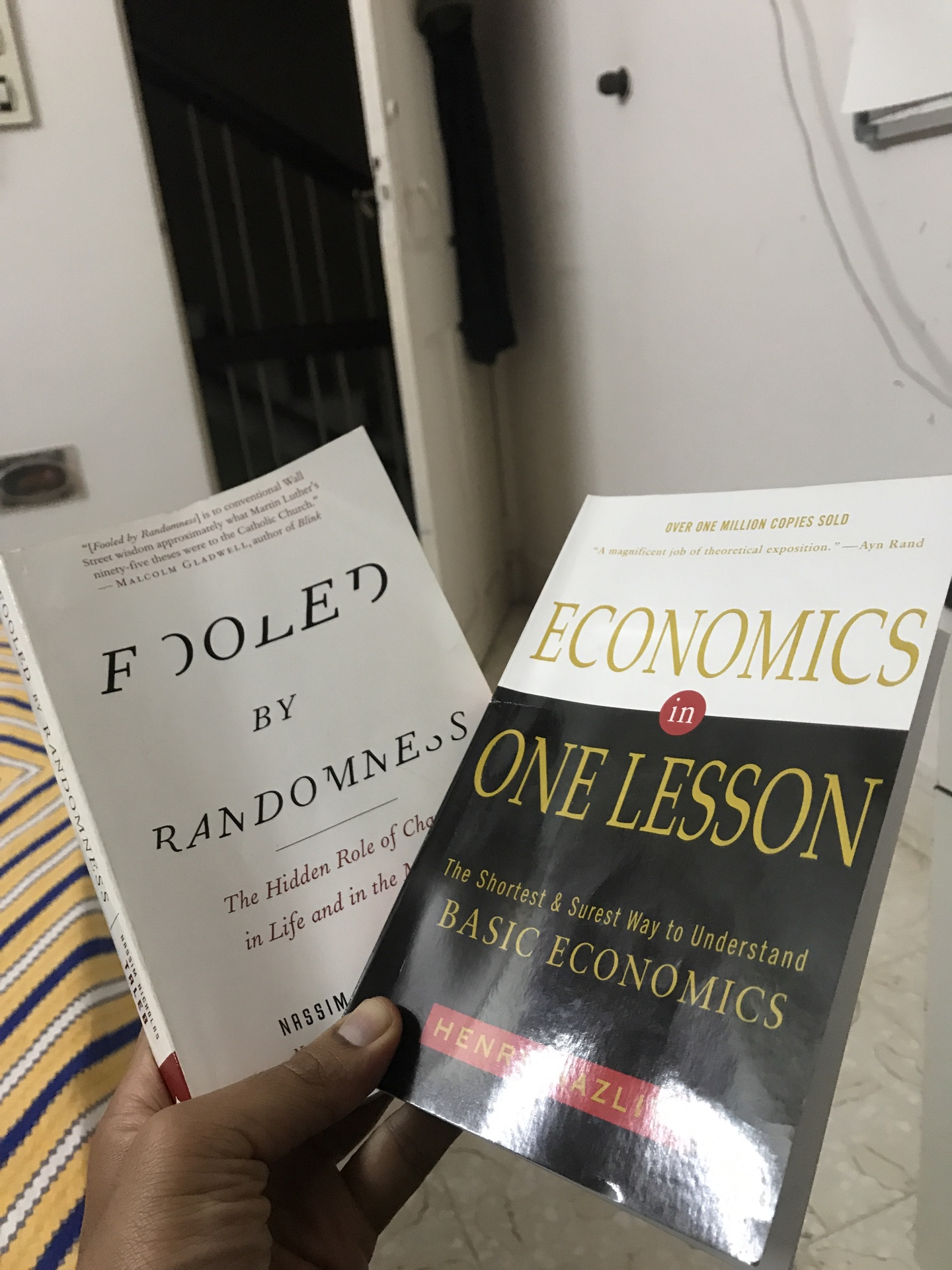 Two books that I am reading - Fooled by Randomness and Economics in one lesson